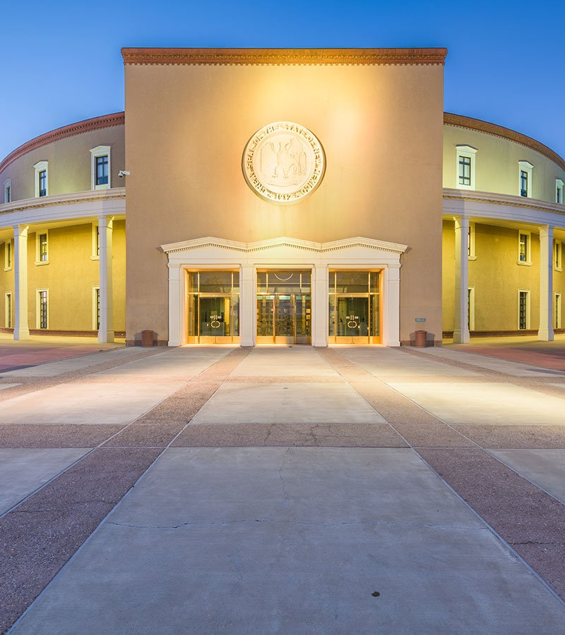 New Mexico State Capitol Building Exterior lit up for dusk